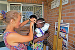 Kimberly Shavender Taking Measurements of Child