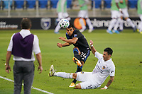 SAN JOSE, CA - OCTOBER 03: Nick Lima #24 of the San Jose Earthquakes is defended by Cristian Pavon #10 of the Los Angeles Galaxy during a game between Los Angeles Galaxy and San Jose Earthquakes at Earthquakes Stadium on October 03, 2020 in San Jose, California.