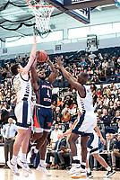 WASHINGTON, DC - NOVEMBER 16: Javier Langarica #32 of George Washington blocks a shot by Kyson Rawls #4 of Morgan State during a game between Morgan State University and George Washington University at The Smith Center on November 16, 2019 in Washington, DC.