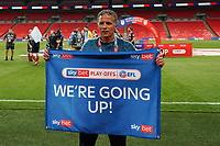 Northampton Town manager Keith Curle celebrates promotion to League One after a 4-0 victory in the Sky Bet League 2 PLAY-OFF Final match between Exeter City and Northampton Town at Wembley Stadium, London, England on 29 June 2020. Photo by Andy Rowland.