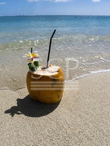 Flic en Flac, Mauritius. La Pirogue tourist resort. Coconut cocktail on the beach.