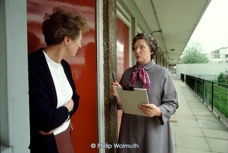 A member of the board of Walterton and Elgin Community Homes, a resident-controlled housing association, consults a resident on Elgin Estate in Paddington, London.