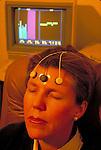 woman and biofeedback computer