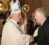 Quebec Premier Jean Charest and Cardinal Marc Ouellet shake hand at the end of Mgr Ouellet farewell Mass in Sainte-Anne-de-Beaupre Basilica, 45 minutes East of Quebec City, August 15 2010. Cardinal Ouellet leaves Quebec for Vatican, as we was recently named Prefect of the Congregation for Bishops and President of the Pontifical Commission for Latin America.<br /> <br /> PHOTO :  Francis Vachon - Agence Quebec Presse