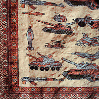 A rug with emblems of war.