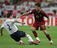 Portuguese forward (17) Cristiano Ronaldo is tackled by English defender (2) Gary Neville.  Portugal defeated England on penalty kicks after playing to a 0-0 tie in regulation in their FIFA World Cup quarterfinal match at FIFA World Cup Stadium in Gelsenkirchen, Germany, July 1, 2006.