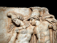 Close up of a Roman Sebasteion relief sculpture of Achilles and a dying Amazon, Aphrodisias Museum, Aphrodisias, Turkey.     Against a black background.<br /> <br /> Achilles supports the dying Amazon queen Penthesilea whom he has mortally wounded. Her double headed axe slips from her hands. The queen had come to fight against the Greeks in the Trojan war and Achilles fell in love with her.