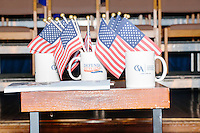 American flags stand in a cup on the stage after Texas senator and Republican presidential candidate Ted Cruz spoke at a town hall put on by the Concerned Veterans for American at Milford Town Hall in Milford, New Hampshire.