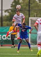 5 September 2014: St. Francis College Terrier Defender Dominick Falanga, a Freshman from Brooklyn, NY, heads the ball over University of Massachusetts River Hawk Nana Osei, a Midfielder Freshman from Ewing, NJ , at Virtue Field in Burlington, Vermont. The River Hawks defeated the Terriers 3-1, on the first day of the Morgan Stanley Smith Barney Windjammer Classic Men's Soccer Tournament. Mandatory Credit: Ed Wolfstein Photo *** RAW (NEF) Image File Available ***