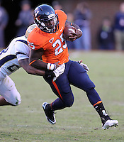 Oct. 15, 2011-Charlottesville, VA.-USA- Virginia Cavaliers running back Kevin Parks (25) is tackled by Georgia Tech cornerback Rashaad Reid (28) during an ACC football game at Scott Stadium. Virginia won 24-21. (Credit Image: © Andrew Shurtleff/
