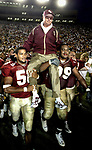 After being dunked with water, Florida State head coach Bobby Bowden  is carried by linebacker Michael Boulware (58) and nose guard Travis Johnson (99)  to midfield to celebrate Bowden's being the winningest active coach in the nation today. FSU's 48-24 victory over Wake Forest gave Bowden his 339th win to pass Joe Paterno of Penn State.  (Mark Wallheiser/TallahasseeStock.com)