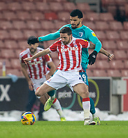 2nd January 2021; Bet365 Stadium, Stoke, Staffordshire, England; English Football League Championship Football, Stoke City versus Bournemouth; Joe Allen of Stoke City is tackled by Dominic Solanke of Bournemouth