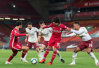 1st October 2020; Anfield, Liverpool, Merseyside, England; English Football League Cup, Carabao Cup, Liverpool versus Arsenal; Takumi Minamino of Liverpool is held by Gabriel of Arsenal as Mohammed Salah of Liverpool wins the ball inside the Arsenal penalty area