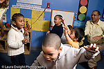 Educaton preschool 4-5 year olds movement dance exercise group of children moving to music horizontal