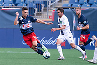 FOXBOROUGH, MA - JULY 4: Collin Verfurth #35 of the New England Revolution II defends as Alex Morrell #7 of Greenville Triumph SC brings the ball forward during a game between Greenville Triumph SC and New England Revolution II at Gillette Stadium on July 4, 2021 in Foxborough, Massachusetts.