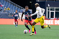 FOXBOROUGH, MA - MAY 16: Michael Mancienne #13 of New England Revolution pressures Gyasi Zardes #11 Columbus SC during a game between Columbus SC and New England Revolution at Gillette Stadium on May 16, 2021 in Foxborough, Massachusetts.