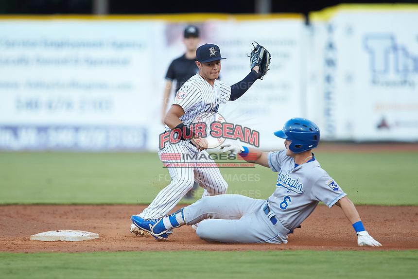 Pulaski Yankees shortstop Jesus Bastidas (12) fields a throw as Michael Massey (6) of the Burlington Royals slides into second base at Calfee Park on September 1, 2019 in Pulaski, Virginia. The Royals defeated the Yankees 5-4 in 17 innings. (Brian Westerholt/Four Seam Images)