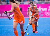 29 JUL 2012 - LONDON, GBR - Naomi van As (NED) of Netherlands makes her way upfield during the women's London 2012 Olympic Games Preliminary round hockey match against Belgium at the Riverbank Arena in the Olympic Park in Stratford, London, Great Britain (PHOTO (C) 2012 NIGEL FARROW)