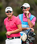 TAOYUAN, TAIWAN - OCTOBER 28:  Yani Tseng of Taiwan and her caddie Paul Fusco smile on the 2nd hole during the day four of the Sunrise LPGA Taiwan Championship at the Sunrise Golf Course on October 28, 2012 in Taoyuan, Taiwan.  Photo by Victor Fraile / The Power of Sport Images