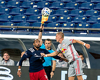 FOXBOROUGH, MA - AUGUST 29: Teal Bunbury #10 of New England Revolution and Patrick Seagrist #7 of New York Red Bulls battle for head ball during a game between New York Red Bulls and New England Revolution at Gillette Stadium on August 29, 2020 in Foxborough, Massachusetts.