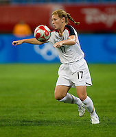 Lori Chalupny. The USWNT defeated New Zealand, 4-0, during the 2008 Beijing Olympics in Shenyang, China.  With the win, the USWNT won group G and advanced to the semifinals.