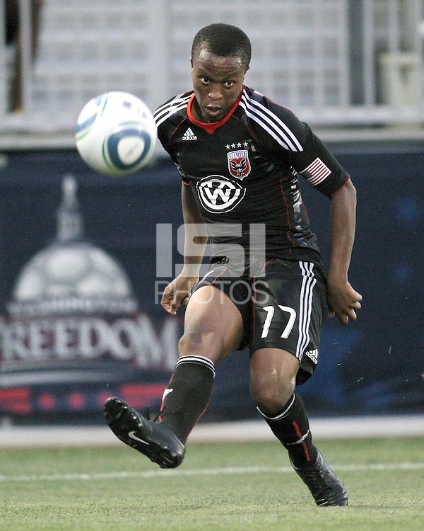 Boyzzz Khumalo #17 of D.C. United sends over a cross that curled into the net for the second goal during a US Open Cup match against the Harrisburg City Islanders at the Maryland Soccerplex on July 21 2010, in Boyds, Maryland. United won 2-0.