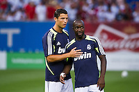 Cristiano Ronaldo (7) of Real Madrid talks with Lass Diarra (24) prior to playing A. C. Milan . Real Madrid defeated A. C. Milan 5-1 during a 2012 Herbalife World Football Challenge match at Yankee Stadium in New York, NY, on August 8, 2012.