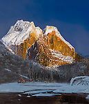 "Paiute Indian village lying in winter snow near the the base of a sunlit mountain, present day Zion National Park circa 1800. Oil on canvas, 35"" x 30""."