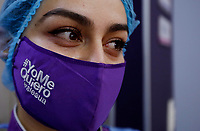 BOGOTA, COLOMBIA - JULY 03, 2020: An employee of a Beauty Care Center covers her face with a mask in Bogota on July 3, 2020. During the Covid-19 pandemic, 180,000 workers are affected by the economic stagnation, resulting in an overall loss of $500 million dollars. (Photo by Leonardo Munoz/VIEWpress via Getty Images)