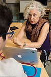 Education High School female teacher working one on one with student, mentoring relationship