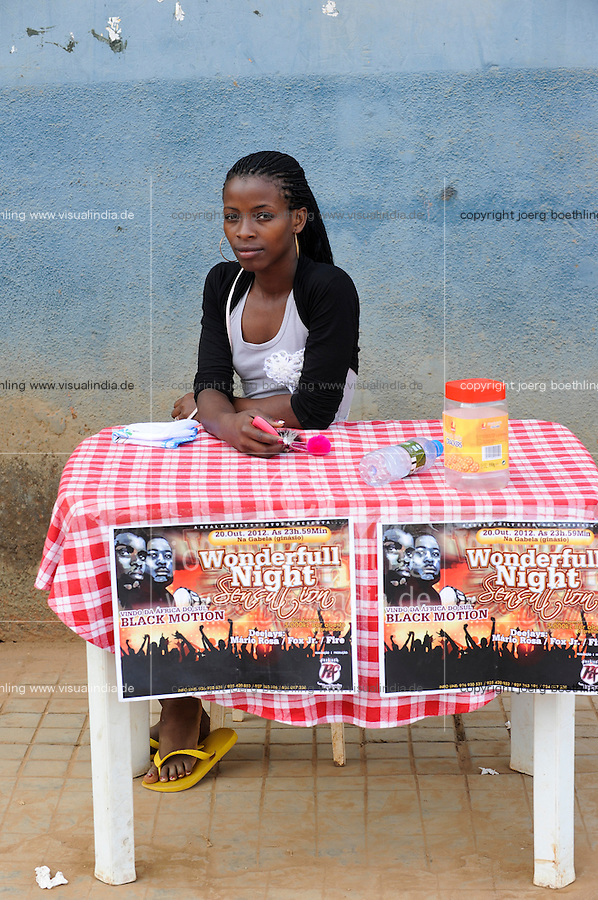ANGOLA Gabela, young woman sells tickets for music party / ANGOLA Gabela, junge Frau verkauft Tickets fuer eine Musikveranstaltung
