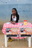 ANGOLA Gabela, young woman sells tickets for music party / ANGOLA Gabela, junge Frau verkauft Tickets fuer eine Musikveranstaltung