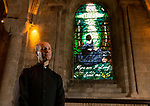 Pictured: Reverend Thomas Wharton, Vicar of Romsey Abbey admires 'The Calling Window' by artist Sophie Hacker which has been newly installed in the Abbey near Southampton, Hants.<br /> <br /> The stained glass window commemorates the bicentenary of Florence Nightingale, and depicts her seated on a stone bench in the grounds of her family home, Embley Park, showing the moment when she said she was called to God's service, aged 16.<br /> <br /> The window, which took over 2 years to design and make, will have a special dedication service currently scheduled for May 2021, which has been delayed due to the coronavirus pandemic. <br /> <br /> © Jordan Pettitt/Solent News & Photo Agency<br /> UK +44 (0) 2380 458800