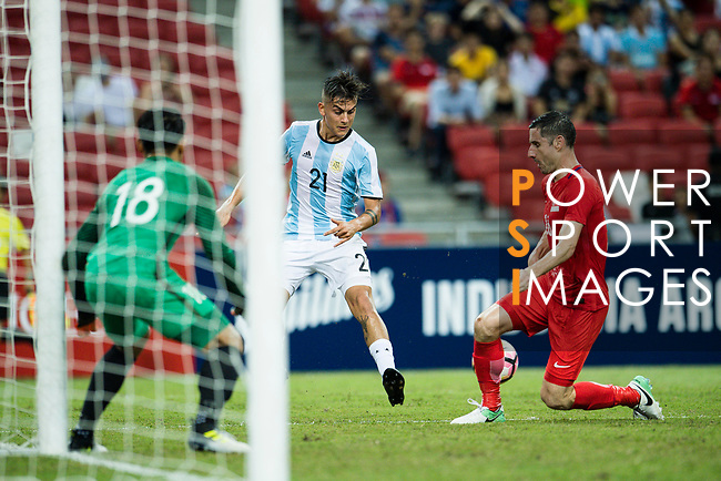 Paulo Dybala of Argentina (C) fights for the ball with Daniel Bannett of Singapure (R) during the International Test match between Argentina and Singapore at National Stadium on June 13, 2017 in Singapore. Photo by Marcio Rodrigo Machado / Power Sport Images