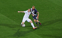 Wayne Rooney (10) of England holds off Jay Demerit (15) of the USA. USA vs England in the 2010 FIFA World Cup at Royal Bafokeng Stadium in Rustenburg, South Africa on June 12, 2010.
