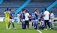 BARRANQUILLA - COLOMBIA, 10-06-2021: Jugadores de Millonarios F. C. en hidratacion durante partido entre Atletico Junior y Millonarios F. C. de ida de las semifinales por la Liga BetPlay DIMAYOR I 2021 jugado en el estadio Metropolitano Roberto Melendez de la ciudad de Barranquilla. / Players of Millonarios F. C. in hydration during a match between Atletico Junior and Millonarios F. C. of the first leg for the BetPlay DIMAYOR I 2021 League played at the Metropolitano Roberto Melendez Stadium in Barranquilla city. / Photo: VizzorImage / Jairo Cassiani / Cont.