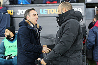 (L-R) Swansea manager Carlos Carvalhal greets Wolverhampton Wanderers head coach Nuno Espirito Santo  during the Emirates FA Cup match between Swansea and Wolverhampton Wanderers at the Liberty Stadium on January 17, 2018 in Swansea, Wales. (Photo by Athena Pictures/Getty Images)