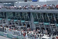 SPECTATORS AT THE F1 GRAND PRIX  SEPANG MALAYSIA MARCH 2008, FORMULA 1 WINNER IN SEPANG MALAYSIA WAS KIMMI RAIKKONEN IN HIS FERRARI FIRST PLACE, SECOND PLACE WENT TO ROBERT KUBICA IN HIS BMW-SAUBER, THIRD PLACE WENT TO HEIKKI KOVALAINEN IN A MCLAREN.