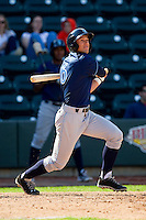 Lane Adams (6) of the Wilmington Blue Rocks follows through on his swing against the Winston-Salem Dash at BB&T Ballpark on April 21, 2013 in Winston-Salem, North Carolina.  The Blue Rocks defeated the Dash 5-3.  (Brian Westerholt/Four Seam Images)
