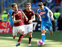 Calcio, Serie A: Roma vs Napoli. Roma, stadio Olimpico, 25 aprile 2016.<br /> Napoli's Dries Mertens, right, is challenged by Roma's Miralem Pjanic, left, and Alessandro Florenzi during the Italian Serie A football match between Roma and Napoli at Rome's Olympic stadium, 25 April 2016.<br /> UPDATE IMAGES PRESS/Riccardo De Luca