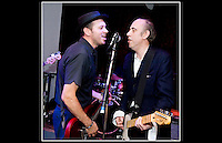 Author Pat Gilbert (L) and Mick Jones (R) share a microphone for a splendid version of 'I Fought The Law' at Billy Bragg's Jail Guitar Doors Hootenanny at The Flowerpot, Kentish Town Road, London NW1 on 12th July 2009.