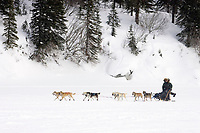 Ramey Smyth kicks down the trail on his way to the White Mountain checkpoint on Tuesday afternoon during Iditarod 2008