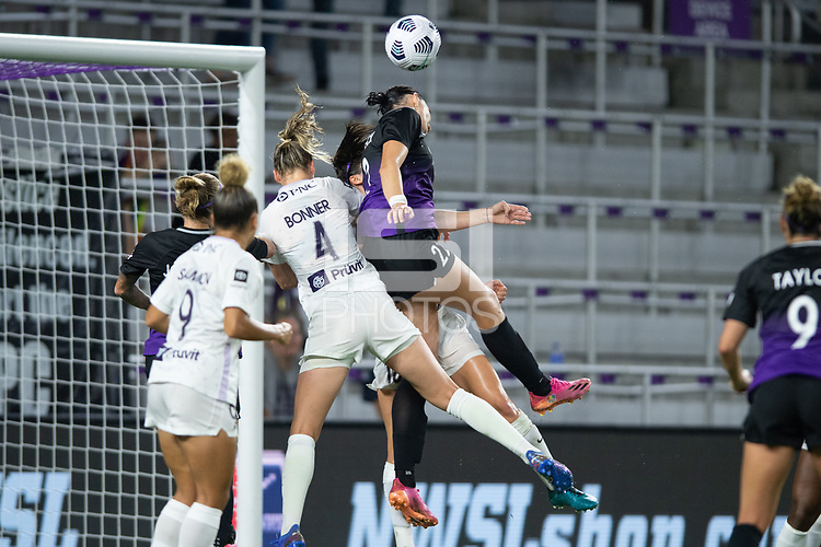 ORLANDO, FL - SEPTEMBER 11: Gemma Bonner #4 of Racing Louisville FC and Taylor Kornieck #22 of the Orlando Pride battle for the ball during a game between Racing Louisville FC and Orlando Pride at Exploria Stadium on September 11, 2021 in Orlando, Florida.
