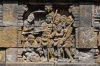 Borobudur, Java, Indonesia.  Bas-relief Stone Carving Representing Scene from Javanese Hindu-Buddhist Mythology.