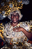 Rio de Janeiro, Brazil. Black lady with silver hair in silver and gold sequinned dress; Carnival.