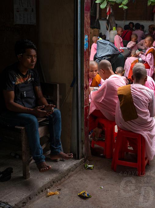 The Jade Market in Mandalay, Myanmar, Burma Buddhist Nuns collecting Alms