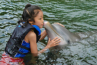 Girl and bottlenose dolphin (Tursiops truncatus), Hawaii, USA (North Pacific Ocean)