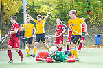 Mannheim, Germany, October 25: During the 1. Bundesliga men fieldhockey match between Mannheimer HC (red) and Harvestehuder THC (yellow) on October 25, 2020 at Am Neckarkanal in Mannheim, Germany. Final score 6-4 (HT 2-3). (Copyright Dirk Markgraf / www.265-images.com) *** Lukas Stumpf #4 of Mannheimer HC, Gonzalo Peillat #2 of Mannheimer HC, Michael Koerper #9 of Harvestehuder THC