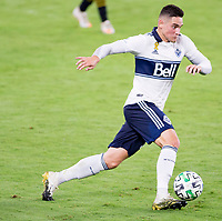 LOS ANGELES, CA - SEPTEMBER 23: Lucas Cavallini #9 of the Vancouver Whitecaps moves with the ball during a game between Vancouver Whitecaps and Los Angeles FC at Banc of California Stadium on September 23, 2020 in Los Angeles, California.