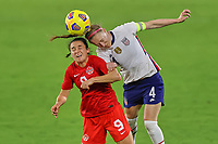 18th February 2021, Orlando, Florida, USA;  Canada forward Evelyne Viens (9) battles with United States defender Becky Sauerbrunn during a SheBelieves Cup game between Canada and the United States on February 18, 2021 at Exploria Stadium in Orlando, FL.